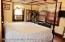 Master bedroom with three windows