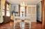 Dining room with crown moldings and French door to right sunroom