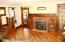 Large formal living room with oak flooring on the diagonal