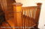 Original wood banister leading to upstairs