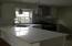 quartz countertops and stainless appliances