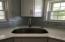 quartz counters and glass tile backsplash