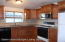 Kitchen is in great condition and has space for a table or corner nook