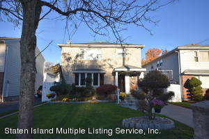 Spacious 5 over 6 two family home on picture perfect, tree lined street.
