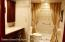 Main bath with large shower.