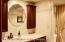 Fully tiled bathroom.