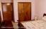 Master bedroom showing closet and pocket door to the main bath.
