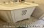 Vanity with marble countertop.