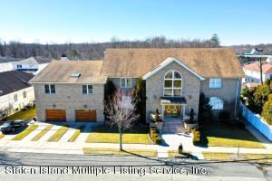 11,970 sq ft house with 4 car garage-2 family w/extra community facility in Basement area plus 3 bedrm 2nd fl apt w/2 full baths,2 kitchens...all on 130 x 113 property