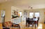 Living Room/Dining Room with Hardwood Floors. Views of the Ocean from All Windows. Also Features French Doors to Upper Deck.