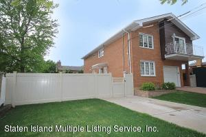 2 Family Solid Brick home with a 2 bedrm apt on the 1st floor....full fin basement all sits on 60 x 100