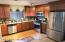 EAT-IN KITCHEN OFFERS CHERRY WOOD CABINETS & 4PC STAINLESS STEEL APPLIANCE PACKAGE