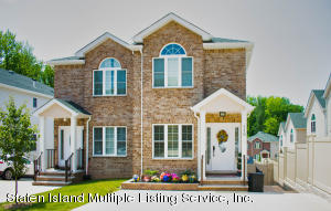 Front of 2 Family Home with 2 Private Driveways
