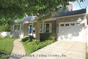 4 bedrm/renovated home with large garage with high ceiling. Large corner property