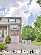 Front view of 2 Family Home on beautiful dead end street location, lush greenery & privacy.