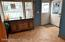 ENTRANCE FOYER/DEN OR OFFICE