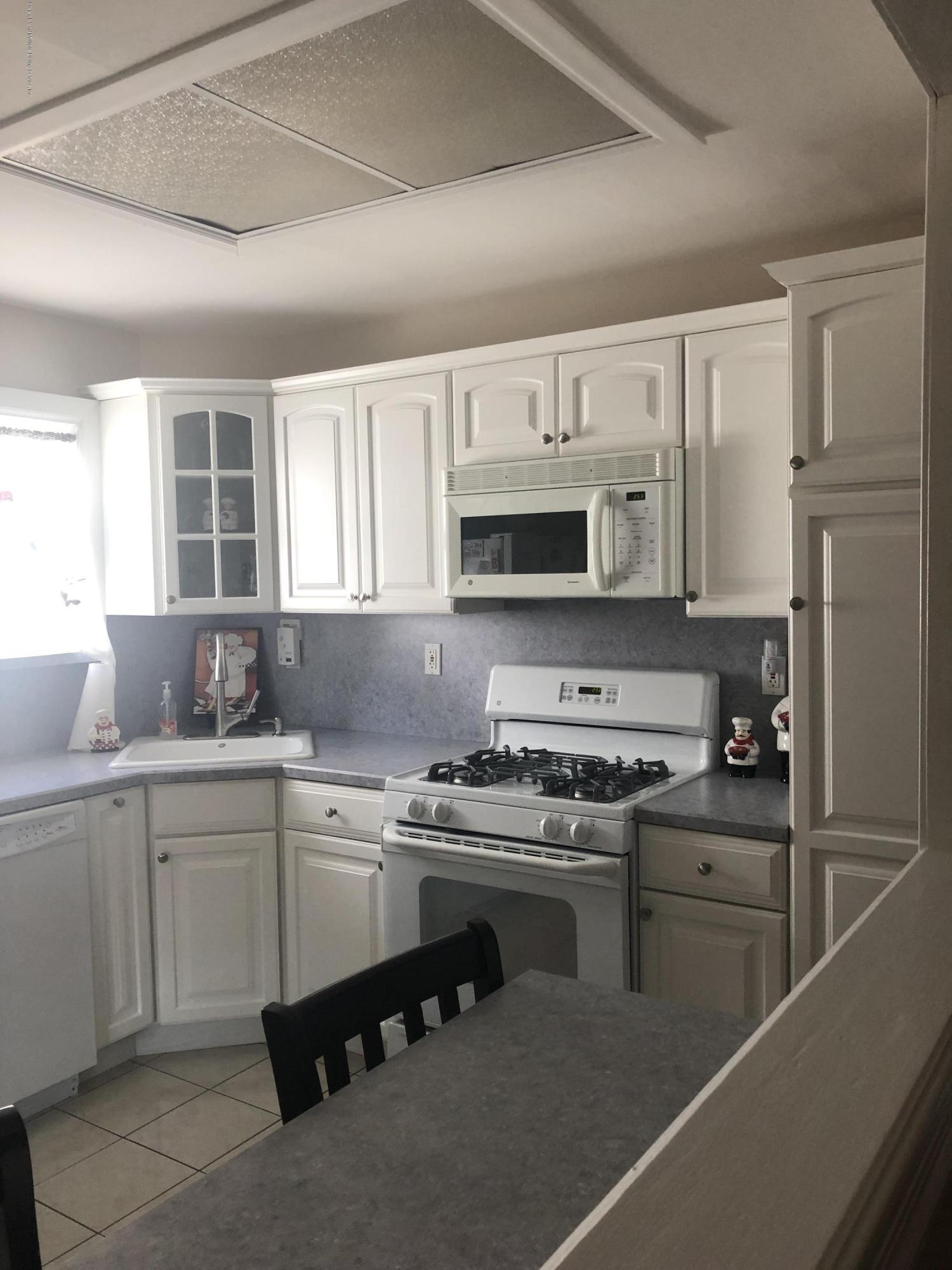 Single Family - Semi-Attached 93 Middle Loop Road  Staten Island, NY 10308, MLS-1131446-11
