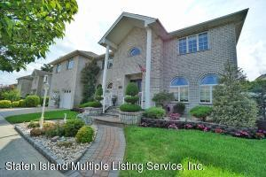CUSTOM 2 FAMILY CHC W/2 CAR GARAGE, 2ND FL 2 BEDRM APT W/CENTRAL AIR & 2 ENTRANCES...ONE FROM INSIDE THE HOUSE & A SIDE ENTRANCE TO THE APT-UPGRADES THRU-OUT-LARGE PROPERTY- CLICK ON THE VIRTUAL TOUR BUTTON UNDER PICTURES