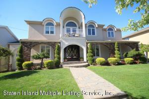 Timeless beauty! One Family Center Hall Colonial on huge 65.5x238.5 property!