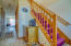 BRIGHT FOYER, WITH HALLWAY TO FAMILY ROOM AND STAIRS TO 2ND FLOOR.