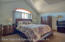 LARGE MASTER BEDROOM WITH TWO CLOSETS.