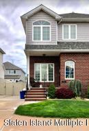 Beautiful Curb Appeal on a Charming Tree-Lined Street