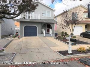 Gorgeous Renovated Extra Large 2 Family Home with Full Finished Basement.