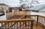 Backyard with deck steps to yard
