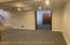Large basement with bonus room and huge storage room and utilities