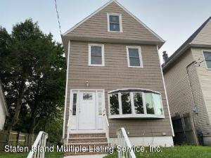 renovated with new 1st layer of a roof, new pella windows, new heating system, new baths, new kitchen, new hardwood floors, new electric & plumbing, new sewer in the street & new sewer line to the house..XTRA LARGE YARD
