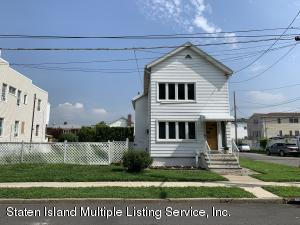 2 Family Colonial on over-sized corner property