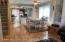 Open & airy dining room with oak floor