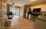Eat in kitchen w/ access to back yard through young Anderson sliding glass door