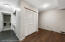Front Foyer space, with closets, laundry, access to additonal room and 3/4 bathroom in rear of house.
