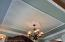 A view of the magnificent custom molding adorning the Formal Dining Room.