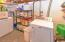 Continue thru workroom to laundry room plus additional storage