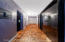 Hallway leading to the bedrooms and bathrooms with two huge closets