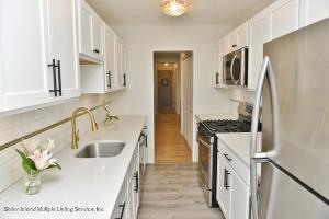 Totally Renovated! Exquisite Kitchen! One of the Largest 2 bedroom 2 bath units, 5th floor, Magnificent Water & Skyline views! Includes Your own Deeded Parking Space in Building. Prepare to be wowed! Don't miss this beauty!