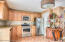 kitchen main floor stainless steel appliances and wood cabinetry