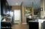 Kitchen features Granite, Dark Wood Cabinets and SS Appliances
