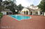 POOL AREA AND SCREENED SUMMER KITCHEN AND DINING AREA WITH FULL BATH/SHOWER