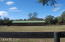 VIEW OF HORSE BARN FROM PASTURE