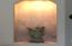 Place your treasured art piece in master bedroom lighted alcove