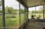 Enjoy the view from the screened porch