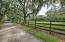 Electric Gated Entrance and Paved Driveway along the Front Pasture