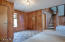 FOYER W/PARQUET FLOOR, CEDAR LINED COAT CLOSET TO LEFT, GUEST ROOMS AND STUDIO/LOFT STAIRWAY TO RIGHT