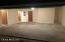View inside Garage, Utility Room Doors off to Left, Door to Kitchen center