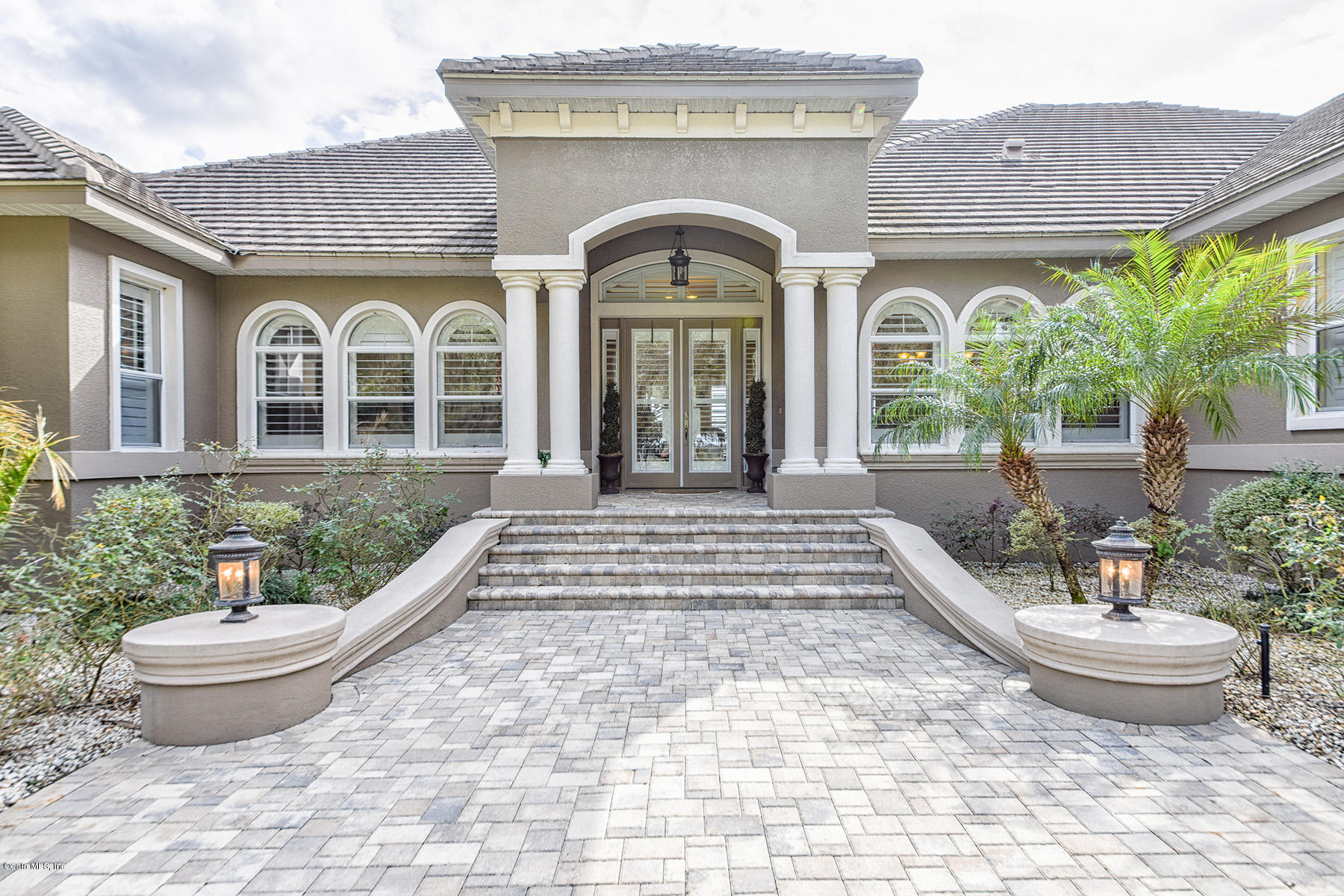 Private Gated Entrance And Beautiful Scattered Granddaddy Oaks Lead You To  A Private 5,000 SF Estate, Meticulously Designed Inside And Out.