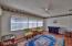 Sunroom features a wide triple window