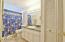 Guest Bath features a linen closet and combination shower/tub